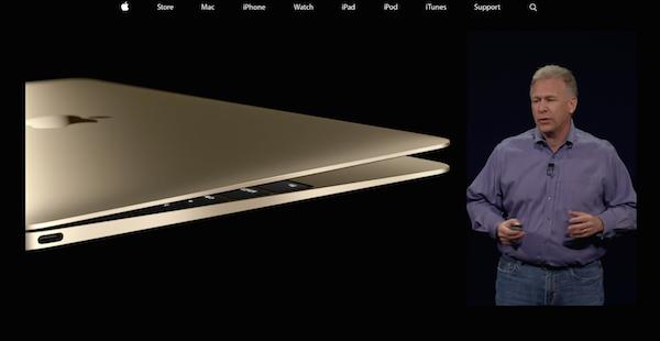 Philip Schiller sul palco con il nuovo MacBook nella colorazione oro.
